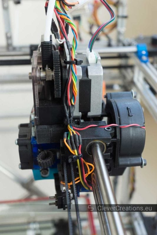 Side view of an extruder carriage in a 3D printer with a geared extruder, pancake NEMA17 stepper motor and a squirrel cage fan.