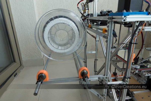 A close-up of a 3D printer filament spool on a spool holder in a 3D printer.