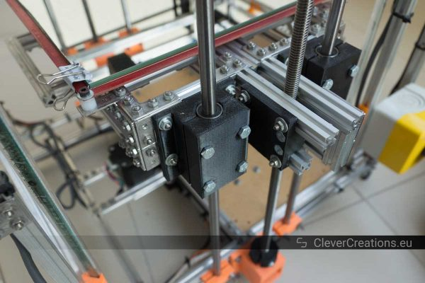 A close-up of Z-stage pulley blocks with LM8UU linear bearings on a DIY 3D printer.