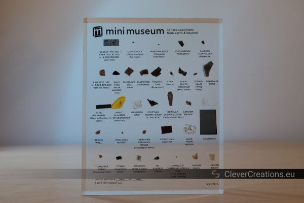 A Mini Museum on a desk in front of a backlit wall.