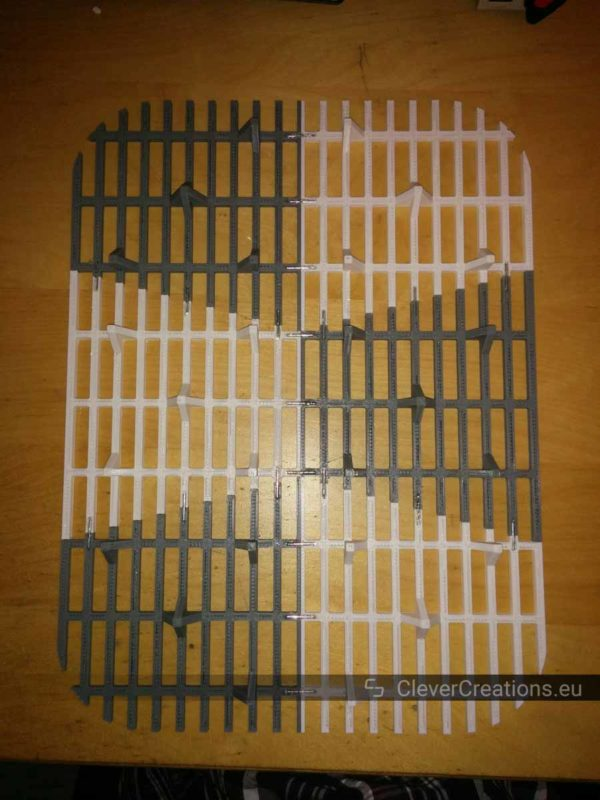 Top view of the bottom of a 3D printed cat litter mat.