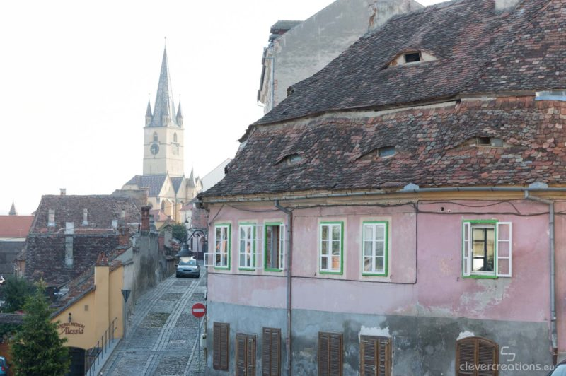 The eyes of Sibiu with a clocktower in the background.