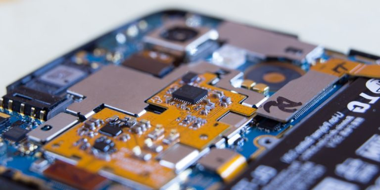 A macro view of the internal printed circuit board of an LG Nexus 5 mobile phone.