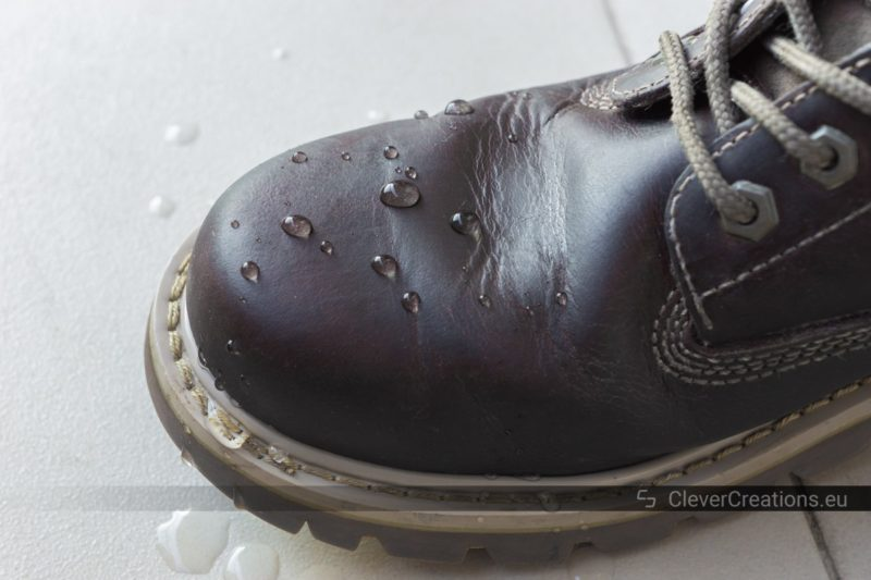 Water beads on top of a waterproofed leather boot.