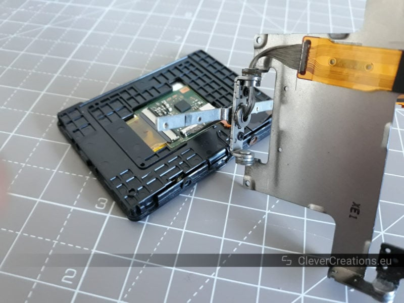 A partially disassembled LCD assembly of a DSLR camera.