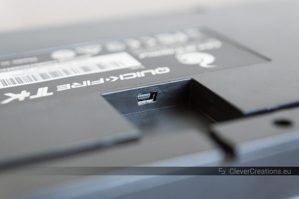 Close-up of the mini-USB connector on the bottom of a Cooler Master Quickfire TK keyboard.