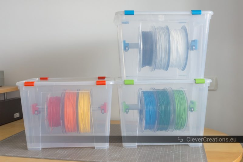 Three IKEA SAMLA storage boxes containing colorful 3D printer filament spools.