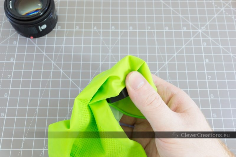A green rubber kitchen glove placed over a 3D printed tool thingy.