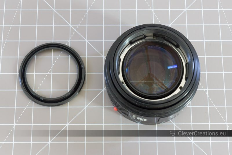 A front decoration ring next to a partially disassembled lens.
