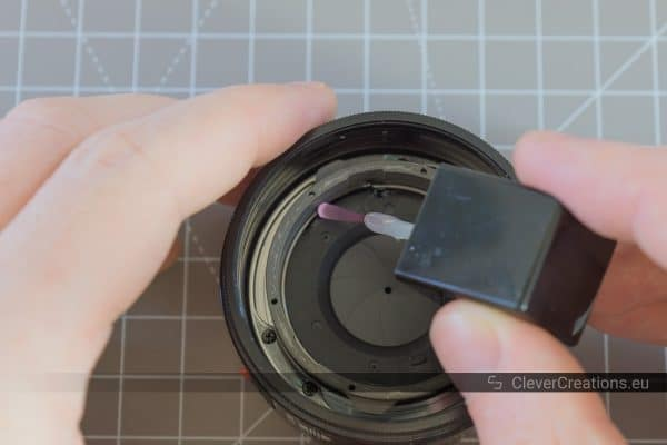Clear nail polish/lacquer being applied to an lens diaphragm retainer spring.