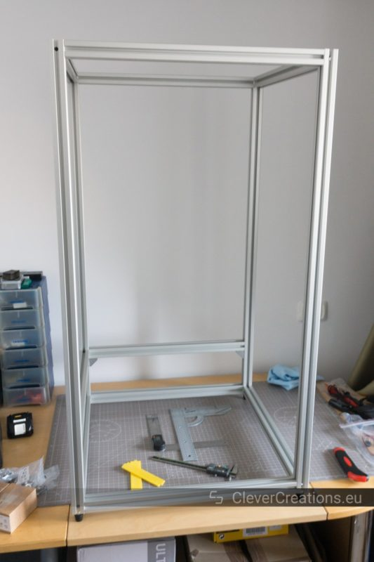 An empty frame of a 3D printer constructed out of 3030 aluminium extrusion.