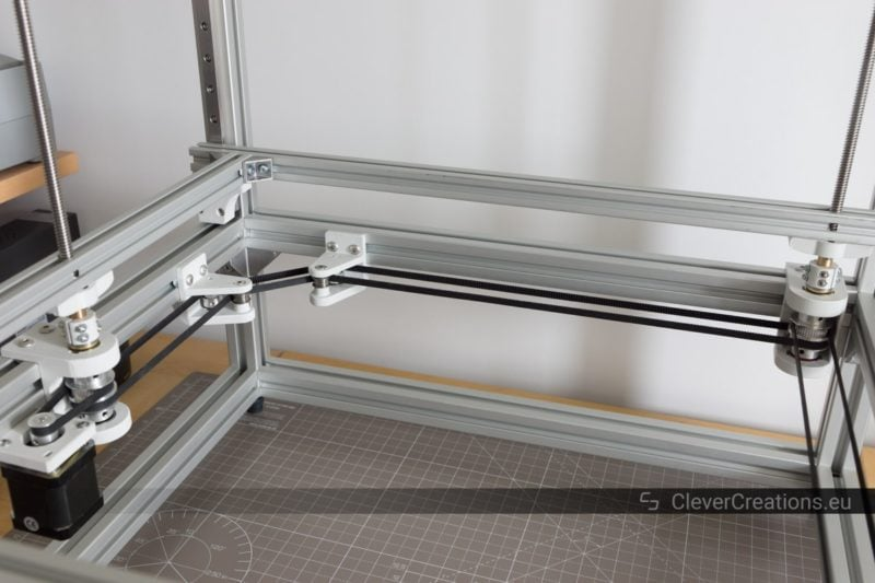A fully assembled and tightened belt system that is part of a triple lead screw system inside a custom built 3D printer.