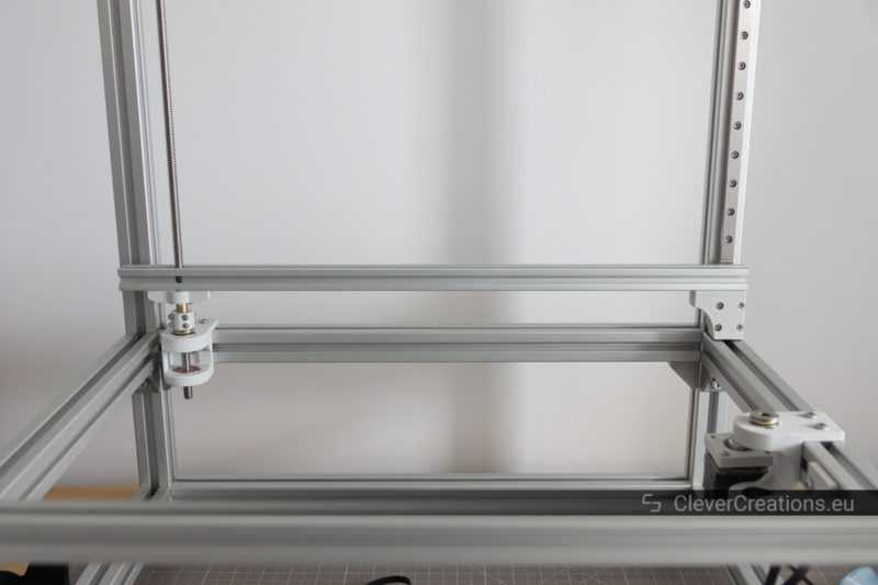 A partially assembled 3D printer made from 3D printed parts, 3030 and 2020 extrusion.