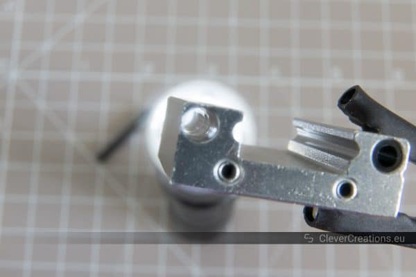 A close-up of one of the ball channels on the inside of a disassembled MGN12H linear rail carriage block.
