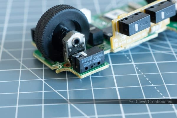 A D2FC-F-7N microswitch on a computer mouse PCB.