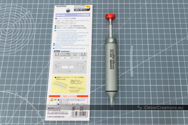 An Engineer SS-02 solder sucker with an extra silicone tube and its manual.