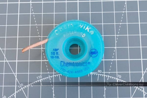 A close-up of a roll of blue ESD-safe desoldering braid.