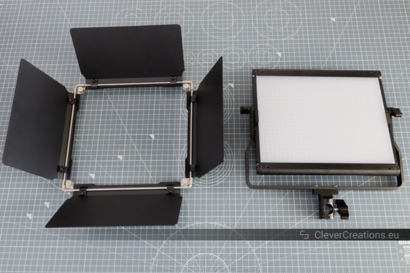 A Neewer 2.4G 660 LED panel next to its barndoor that has been removed.