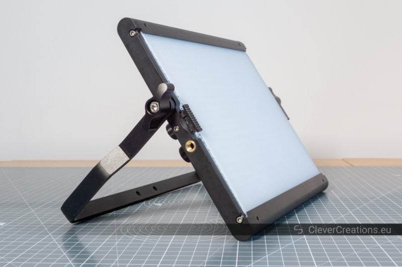 Side view of a Neewer 660 light panel leaning on its U-bracket.