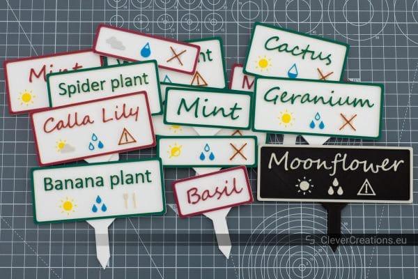 A pile of 3D printed multicolor plant labels.