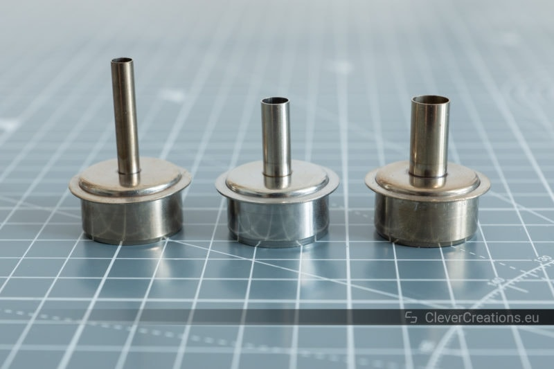 A close-up of three metal hot air nozzles for a Quick 861DW rework station.