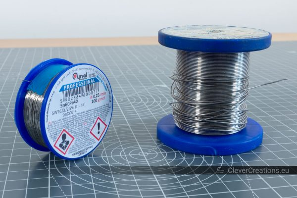 Two rolls of leaded rosin-core 60/40 solder with different diameters.