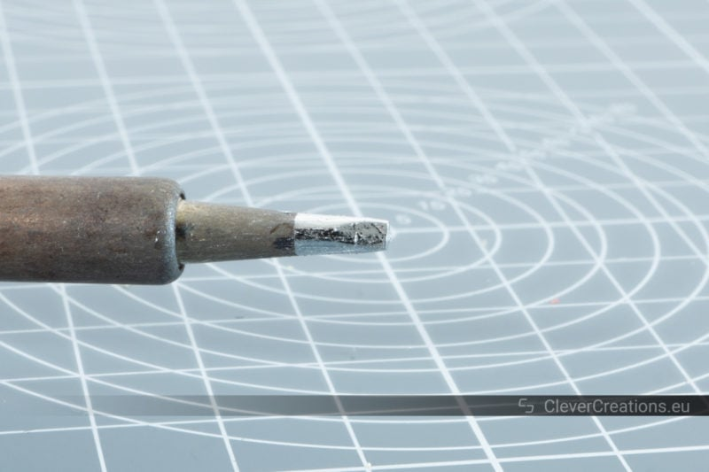 A soldering iron with chisel tip.