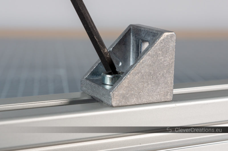 A T-handle Allen key with ball end being used to drive a machine screw.