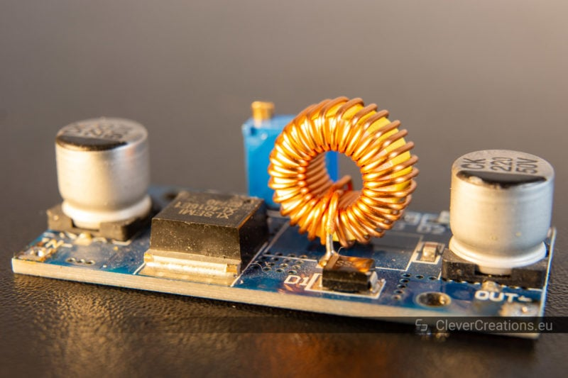 Close-up of a buck converter with toroidal inductor.