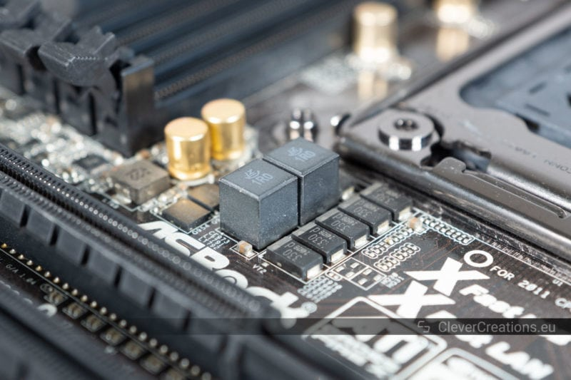 Macro shot of a set of motherboard VRMs with coil whine.