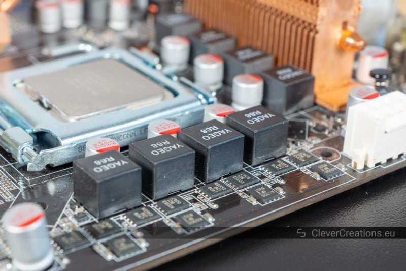 A collection of inductors on a computer motherboard.