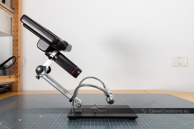 The adjustable arm of the AD407 microscope tilted backwards.