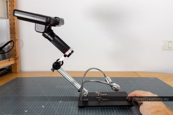 A digital microscope tilting over backwards because its center of gravity is too far back.