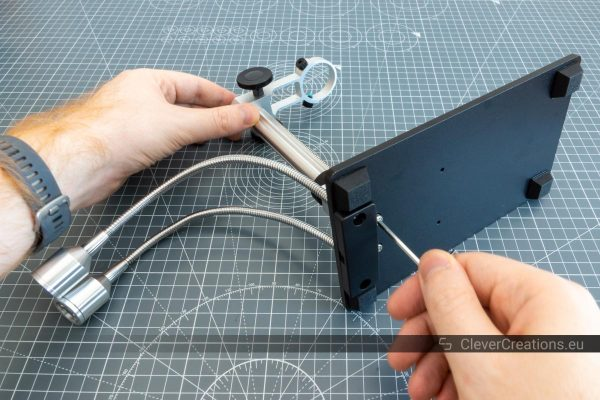Assembling the parts of a digital microscope.