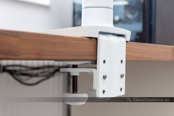 A close-up of the clamping mechanism of the Ergotron HX.