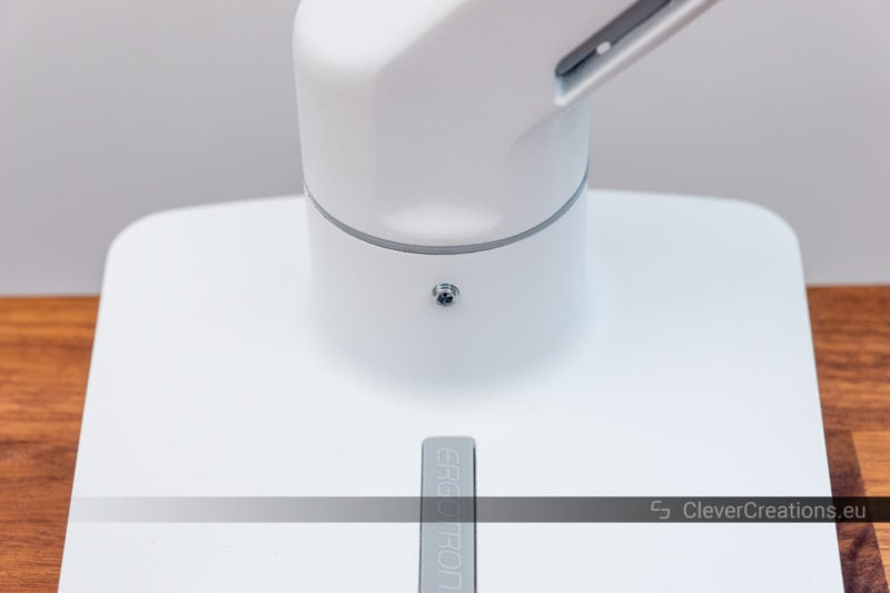 A small grub screw for limiting the rotation of a monitor arm.