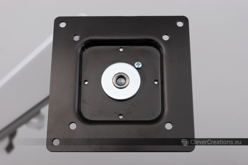 Close-up of a 100x100mm VESA mount with a screw that prevents rotation.