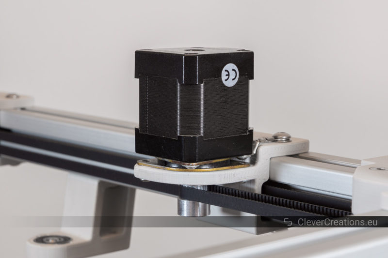 A NEMA17 stepper motor with rubber vibration dampener mounted to an aluminum extrusion frame.