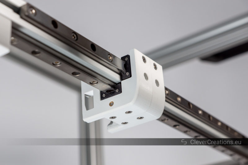 A close-up of a compact 3D printer extruder carriage that uses two MGN9 rails and carriages.