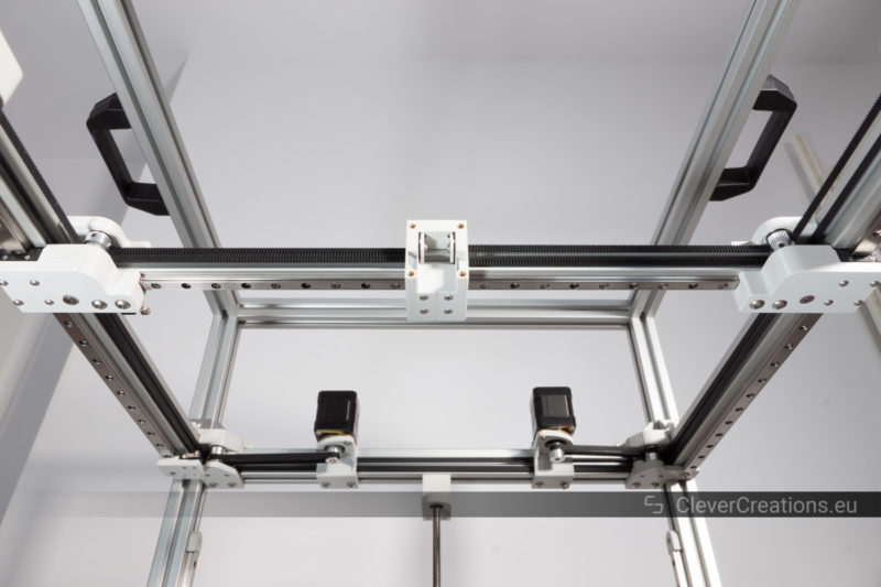 The bottom of a coreXY motion system using aluminum extrusion and MGN12 and MGN9 linear guide rails.