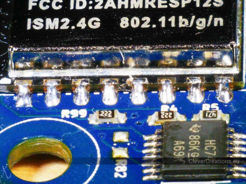 A screenshot from a digital microscope screen that shows eight soldered pins of an ESP8266 wireless module.