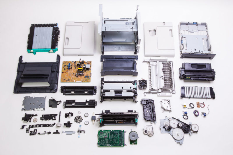 A disassembled printer for salvaging components
