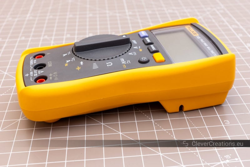 Side view of a yellow multimeter holster.