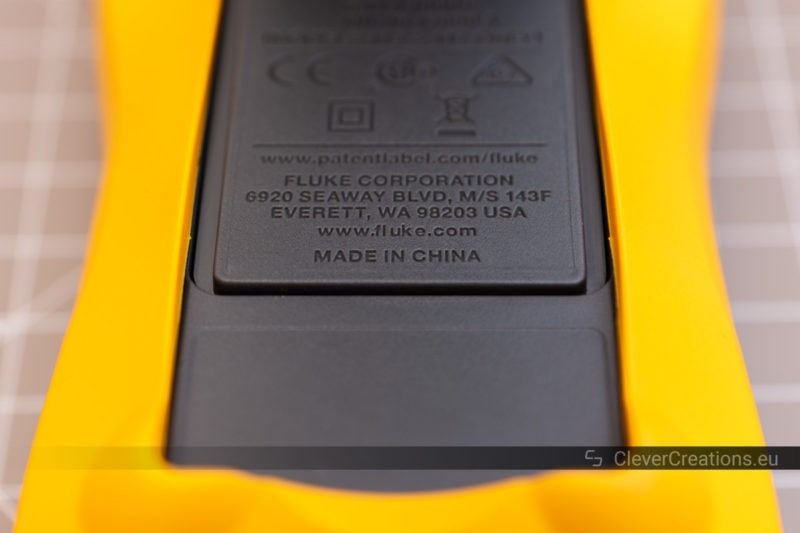 Close-up of inset 'Made in China' text the black molded plastic of a Fluke multimeter.