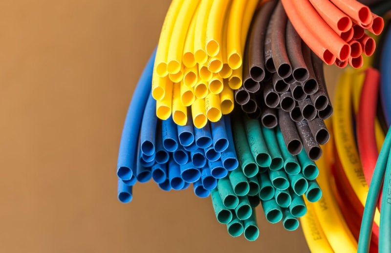 A bundle with several rolls of variously colored heat shrink tubing.