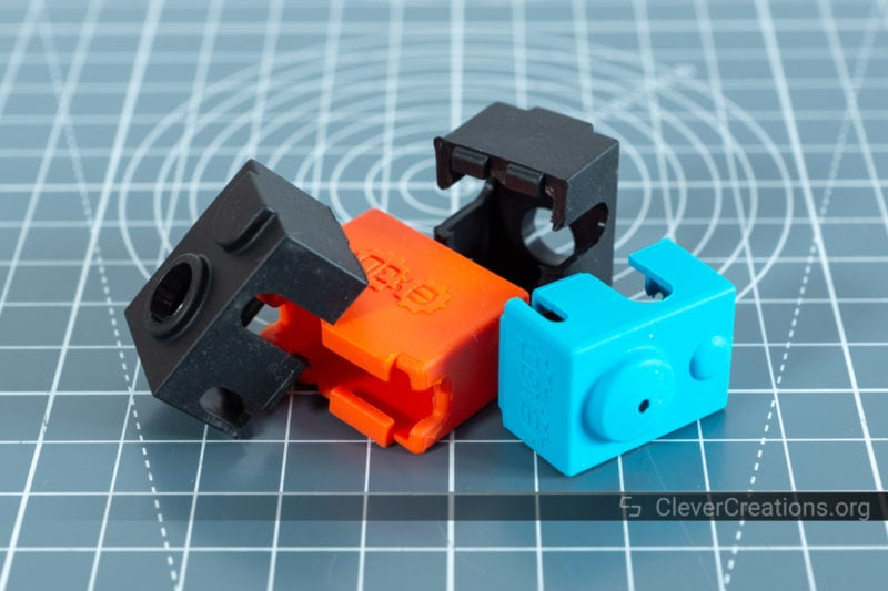 A close-up of a pile of silicone sock covers for insulating 3D printer hotends.