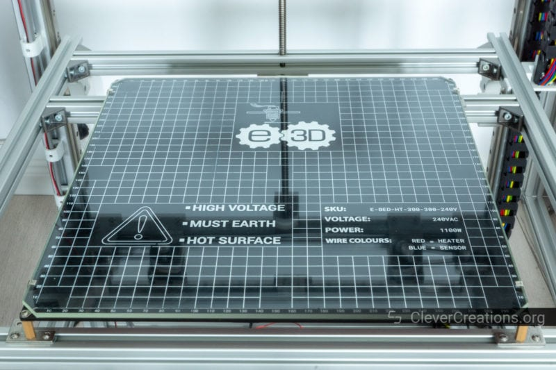 A large 30x30 cm E3D 1100W heated bed in a 3D printer.