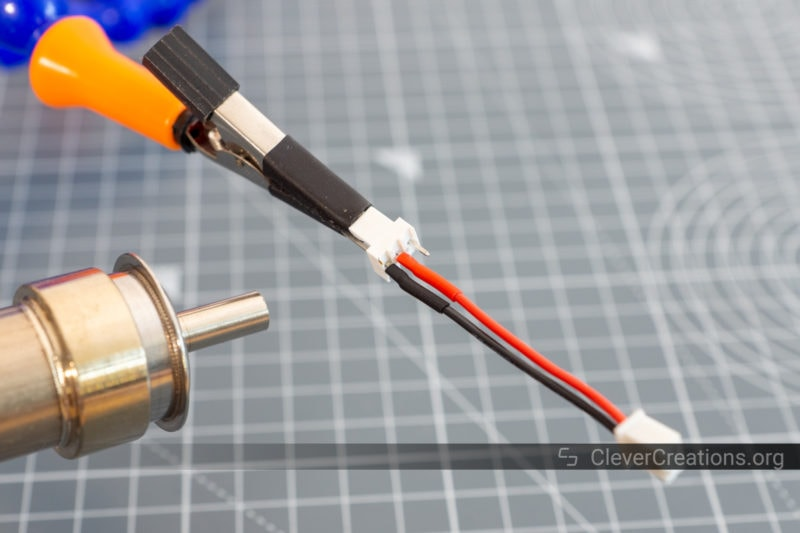 A hot air gun being used to shrink heat shrink tubing.