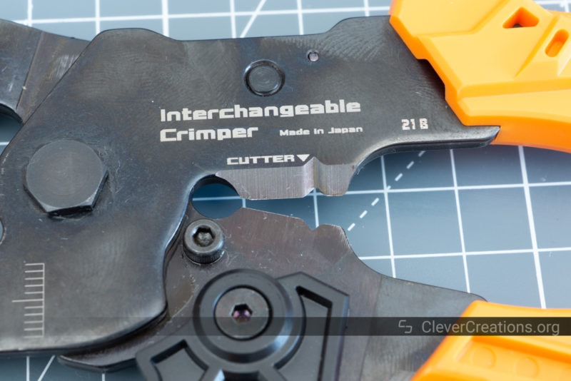 Close-up of the wire cutter/stripper embedded in the crimping tool of a PAD-02 kit.