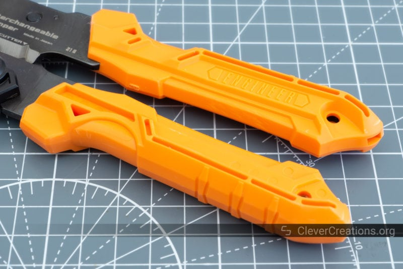 Orange oil-resistant thermoplastic rubber handles on an Engineer crimp tool.